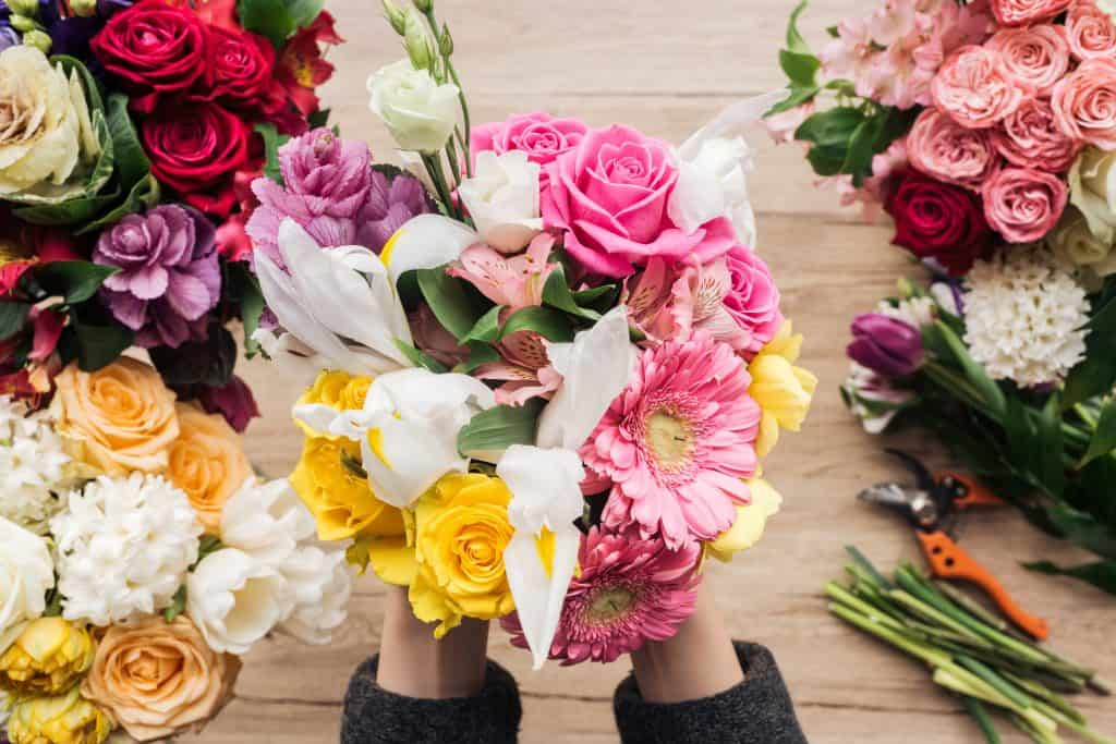 Holding beautiful Flowers while Accepting God's Love