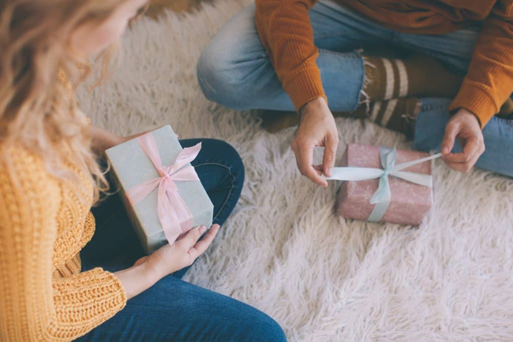 Two people exchanging gifts to show their love