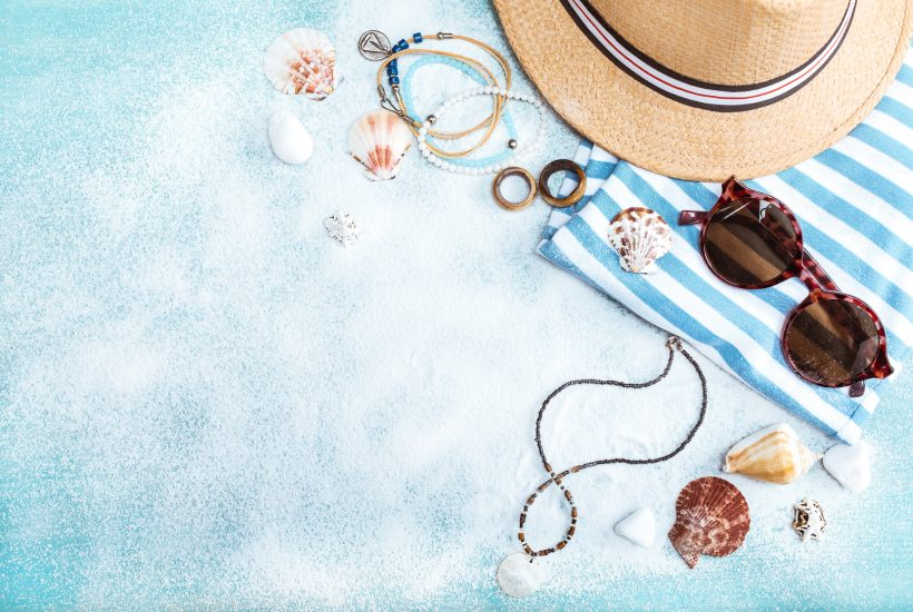 a group of summer holiday items on a blue background