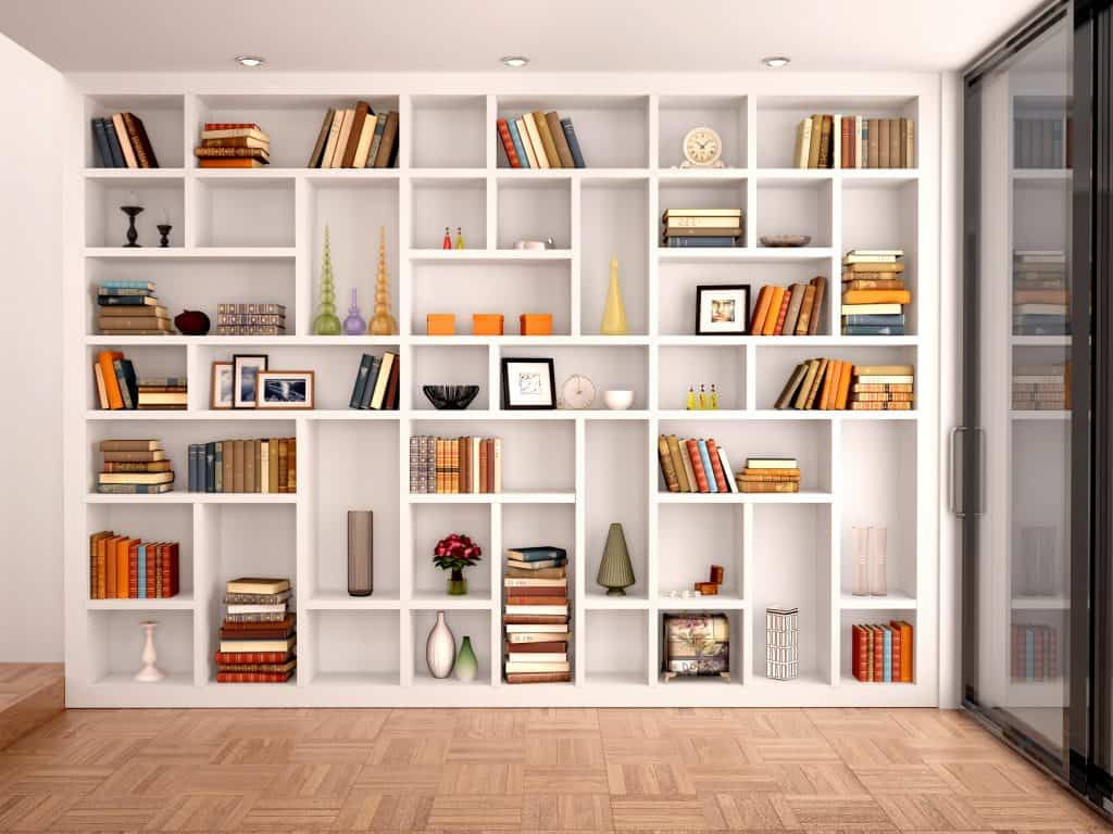 A bookshelf in someone's first apartment
